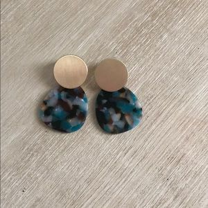 Tortoise shell earrings. With colors of blue